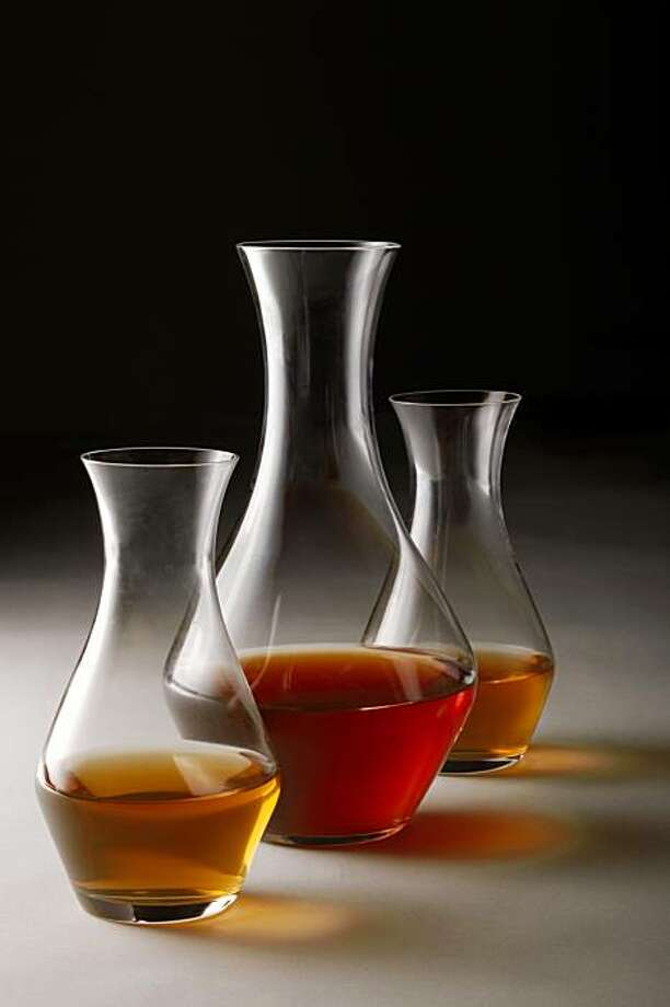 "Decanters of ""orange wine,"" whie wine that has been fermented on its skins and is more orange and cloudy than bright yellow in San Francisco, Calif., on September 30, 2009. Photo: Craig Lee, Special To The Chronicle"