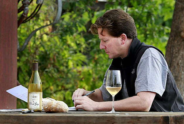 Pax Mahle works on his notes as he enjoys a glass of his skin fermented Pinot Gris. Winemaker Pax Mahle makes skin-fermented white wines, letting the wine sit in the grape skins for a long time to gain texture and color for his Trousseau and Pinot Gris varieties in Forestville, CA Photo: Brant Ward, The Chronicle
