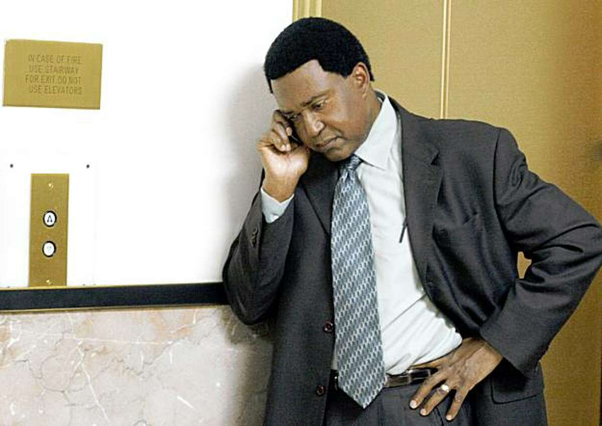 """Attorney John Burris, who is representing Oscar Grant's family in a $50 million federal civil rights lawsuit against BART, takes a phone call outside Judge Morris Jacobson, Superior Courtroom in Oakland, after the judge's decision of a change of venue, citing the """"substantial media attention"""" and Mehserle's Sixth Amendment rights to an impartial jury."""