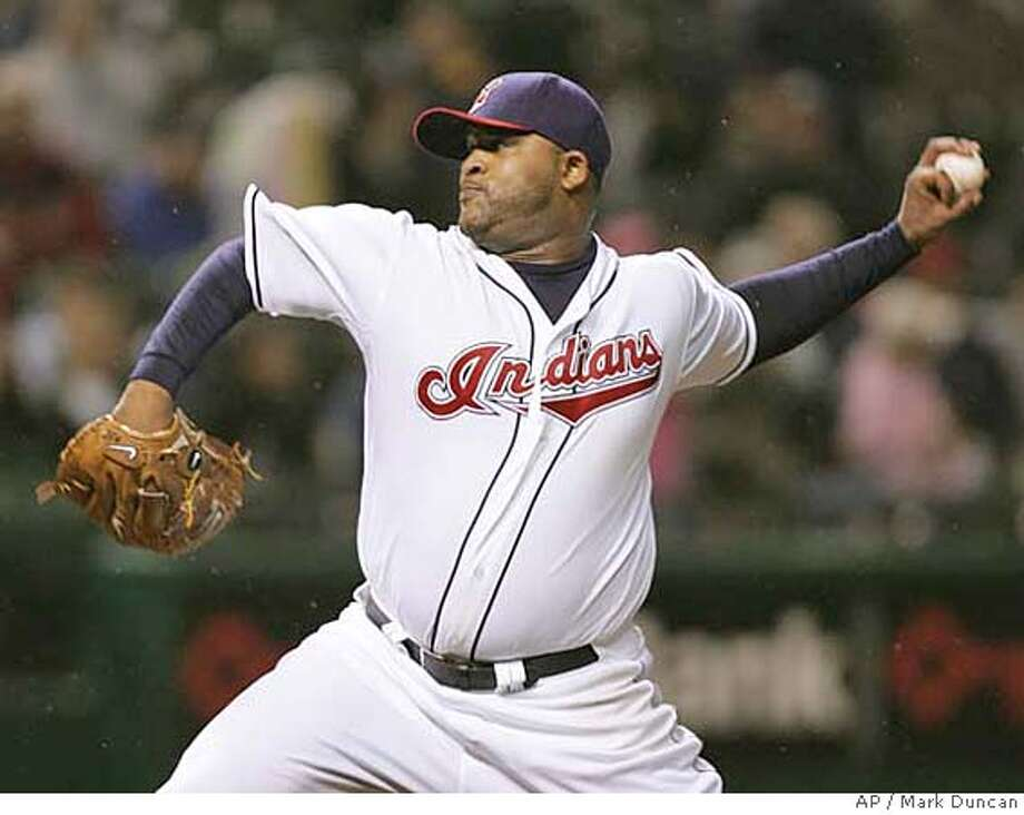 Cleveland Indians' C.C. Sabathia pitches to Oakland Athletics' Emil Brown in the ninth inning of a baseball game Wednesday, May 14, 2008, in Cleveland. Sabathia struck out Brown, his 11th strikeout of the game, to complete a 2-0 shutout. (AP Photo/Mark Duncan) Photo: Mark Duncan