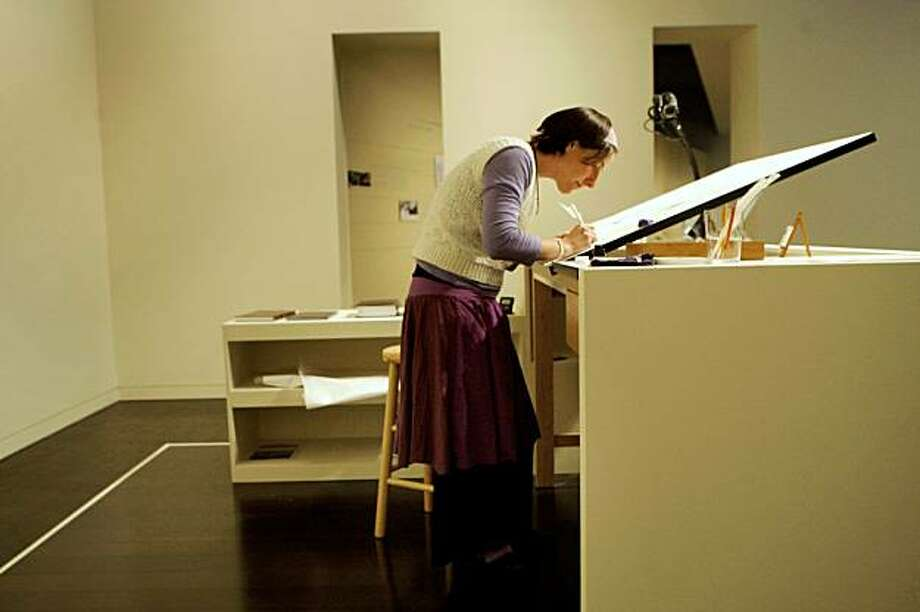 "Julie Seltzer demonstrates her writing at the Contemporary Jewish Museum at the ""As It Is Written: Project 304,805"" exhibit in San Francisco, Calif. on Thursday October 8, 2009. Seltzer is a soferet, a professionally trained female scribe, who will be a living exhibit in ""As It Is Written: Project 304,805, "" where she will write out the entire text of the Torah over the course of a full year at the Contemporary Jewish Museum. Photo: Lea Suzuki, The Chronicle"