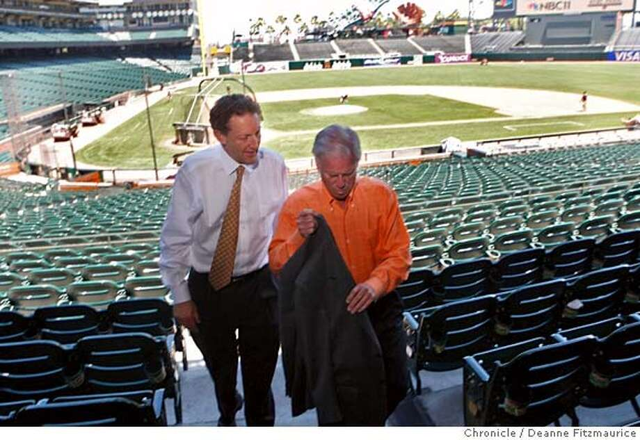 ###Live Caption:Peter Magowan, right, President of the San Francisco Giants, walks with Larry Baer at AT&T Park. He announced he is stepping down from that position in San Francisco, Calif. on May 16, 2008.  Photo by Deanne Fitzmaurice / San Francisco Chronicle###Caption History:Peter Magowan, right, President of the San Francisco Giants, walks with Larry Baer at AT&T Park. He announced he is stepping down from that position in San Francisco, Calif. on May 16, 2008.  Photo by Deanne Fitzmaurice / San Francisco Chronicle###Notes:###Special Instructions:MANDATORY CREDIT FOR PHOTOG AND SAN FRANCISCO CHRONICLE/NO SALES-MAGS OUT Photo: Deanne Fitzmaurice