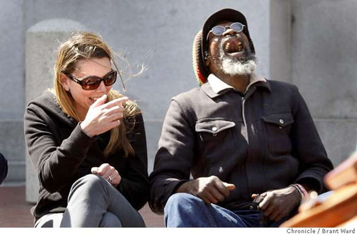 ###Live Caption:University student Danielle Siragusa, left, and homeless person Sangea Easy share a laugh in the plaza in San Francisco, Calif. on Monday, May 12, 2008. A San Francisco State University anthropology class has been studying daily life in United Nations Plaza. Photo by Brant Ward / The Chronicle###Caption History:University student Danielle Siragusa, left, and homeless person Sangea Easy share a laugh in the plaza. A San Francisco State University anthropology class has been studying daily life in United Nations Plaza in San Francisco, Calif. on Monday, May 12, 2008. Photo by Brant Ward / The Chronicle###Notes:###Special Instructions: