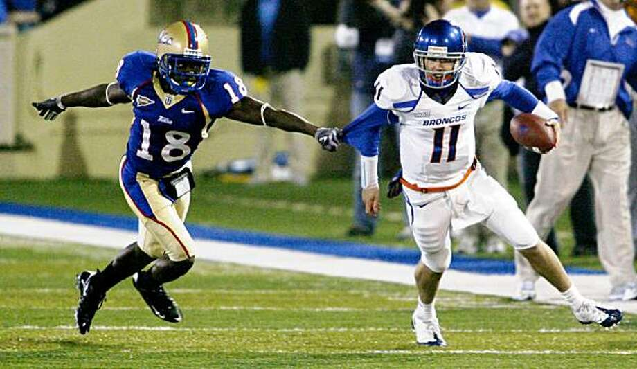 Boise State's Kellen Moore runs away from Tulsa's John Destin on a quarterback keeper during an NCAA college football game in Tulsa, Okla., on Wednesday, Oct. 14, 2009. Boise State won 28-21. Moore threw two touchdown passes. (AP Photo/David Crenshaw) Photo: David Crenshaw, AP