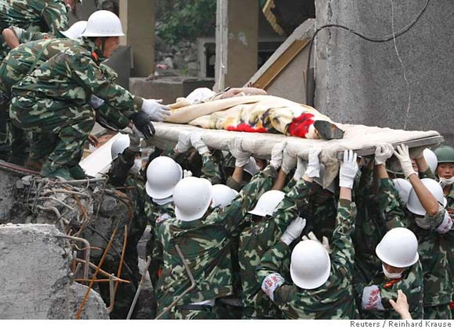 ###Live Caption:Soldiers rescue a man who survived in the rubble of a chemical factory in Shifang, Sichuan province May 16, 2008. An aftershock brought new havoc to the earthquake-stricken region of China on Friday, as it struggled to bury some of its estimated 50,000 dead, dig out more survivors and help thousands of injured and homeless. Picture taken May 16, 2008. REUTERS/Reinhard Krause (CHINA)###Caption History:Soldiers rescue a man who survived in the rubble of a chemical factory in Shifang, Sichuan province May 16, 2008. An aftershock brought new havoc to the earthquake-stricken region of China on Friday, as it struggled to bury some of its estimated 50,000 dead, dig out more survivors and help thousands of injured and homeless. Picture taken May 16, 2008. REUTERS/Reinhard Krause (CHINA)###Notes:Soldiers rescue a man who survived in the rubble of a chemical factory in Shifang###Special Instructions:0 Photo: REINHARD KRAUSE