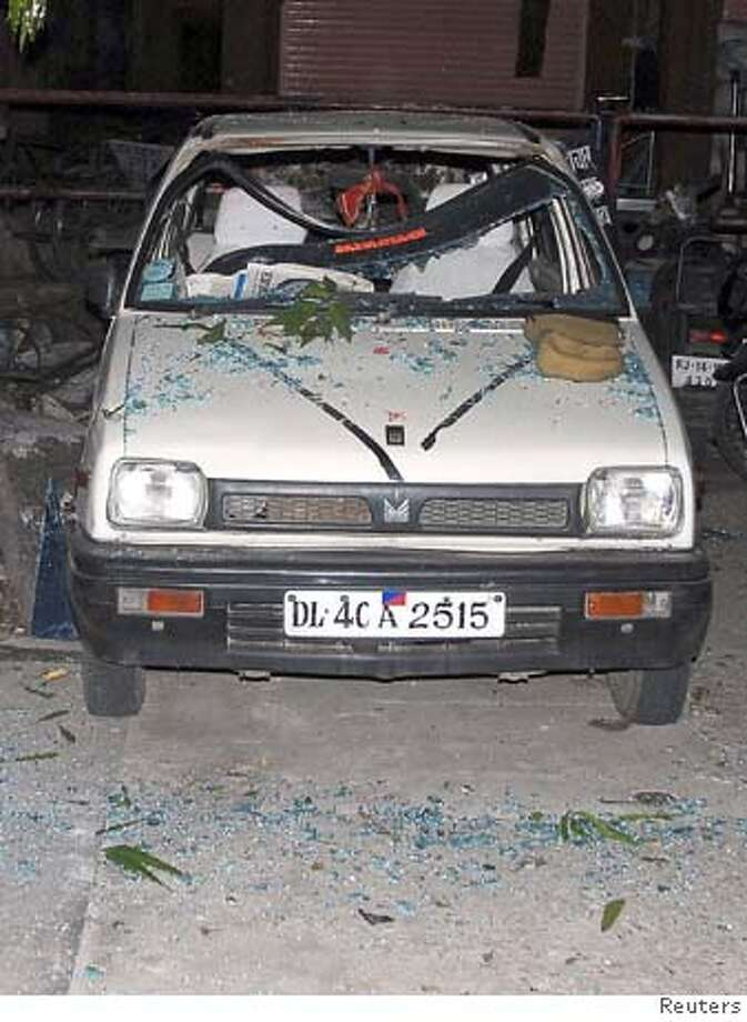 ###Live Caption:A damaged car is seen at the site of a bomb blast in Kotwali in the western Indian city of Jaipur May 13, 2008. More than 60 people were feared killed in bomb blasts in Jaipur on Tuesday, state television said, citing Chief Minister Vasundhara Raje. REUTERS/Stringer (INDIA)###Caption History:A damaged car is seen at the site of a bomb blast in Kotwali in the western Indian city of Jaipur May 13, 2008. More than 60 people were feared killed in bomb blasts in Jaipur on Tuesday, state television said, citing Chief Minister Vasundhara Raje. REUTERS/Stringer (INDIA)###Notes:A damaged car is seen at the site of a bomb blast in Kotwali in western Indian city of Jaipur###Special Instructions: Photo: STRINGER/INDIA