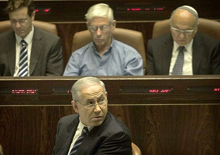 JERUSALEM - OCTOBER 12: Israeli Prime Minister Benjamin Netanyahu attends the opening of the winter session of the Knesset, Israel's Parliament, October 12, 2009 in Jerusalem, Israel. Netanyahu said that Israel would not allow its citizens to be tried for alleged war crimes over the Gaza war and that adopting a damning UN report on the offensive endangered the stalled peace process. (Photo by Dan Balilty-Pool/Getty Images) Photo: Pool, Getty Images