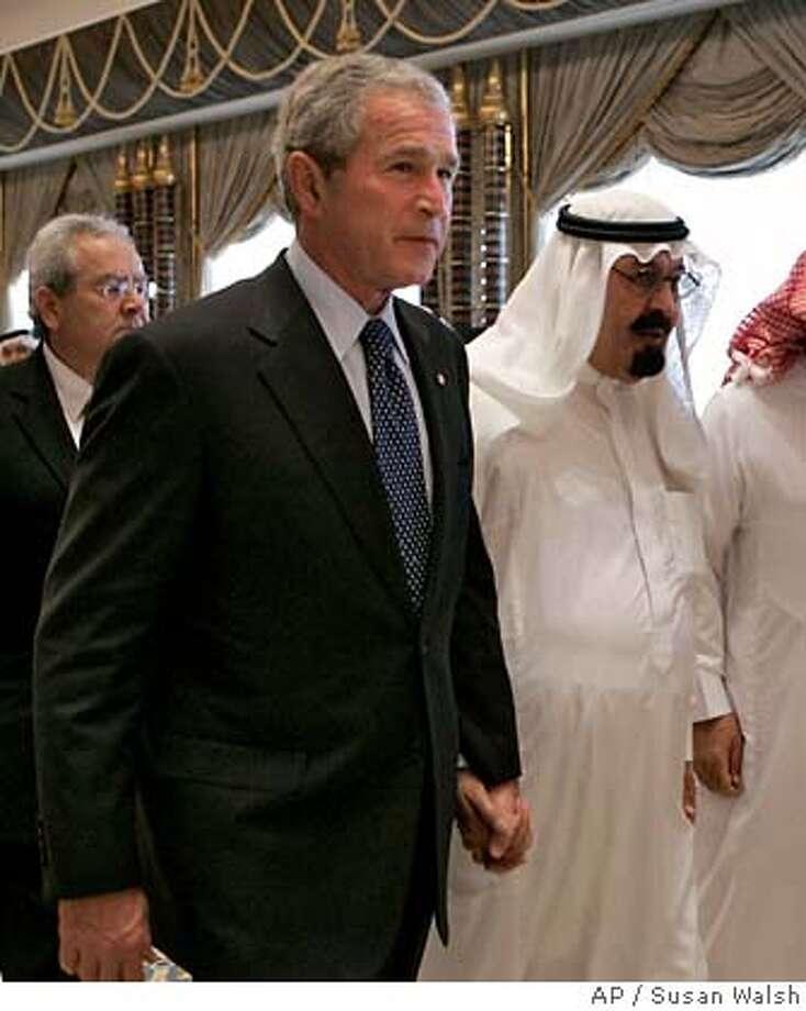 President Bush walks with Saudi King Abdullah after a signing ceremony at the Al Janadriyah Ranch in Riyadh, Saudi Arabia, Friday, May 16, 2008. (AP Photo/Susan Walsh) Photo: Susan Walsh