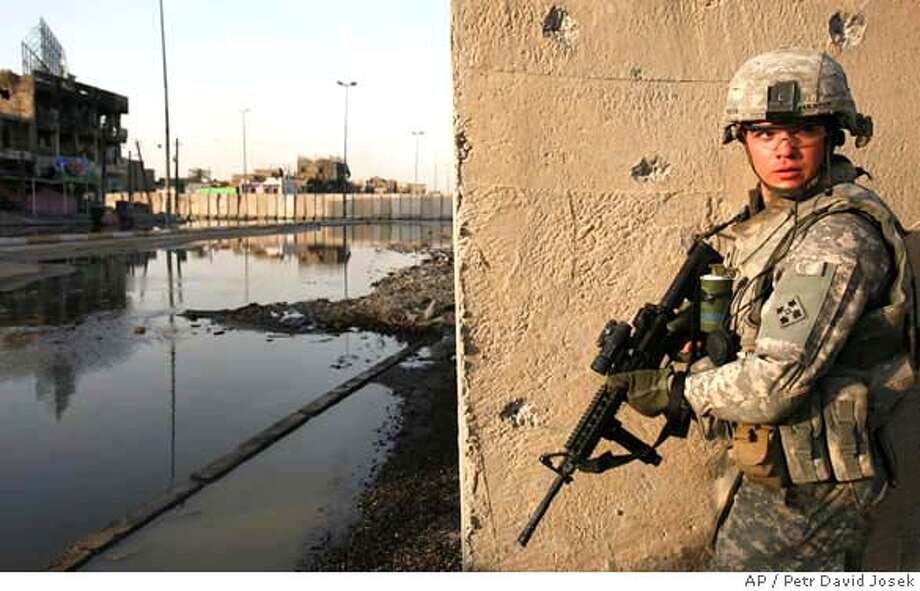 ###Live Caption:U.S. Army soldier from the 3rd Special Troops Battalion, 3rd Brigade Combat Team, 4th Infantry Division takes up a position in front of a patrol base in the Shiite enclave of Sadr City in Baghdad, Iraq, Monday, May 12, 2008. In the background is the 12-foot concrete barrier that is being built along a main street dividing southern Sadr city from north, where Mahdi army fighters are concentrated. U.S. commanders hope the wall will effectively cut off insurgents ability to move freely around Baghdad and hamper their ability to fire rockets at the Green Zone, where Government offices are concentrated. (AP Photo/Petr David Josek)###Caption History:U.S. Army soldier from the 3rd Special Troops Battalion, 3rd Brigade Combat Team, 4th Infantry Division takes up a position in front of a patrol base in the Shiite enclave of Sadr City in Baghdad, Iraq, Monday, May 12, 2008. In the background is the 12-foot concrete barrier that is being built along a main street dividing southern Sadr city from north, where Mahdi army fighters are concentrated. U.S. commanders hope the wall will effectively cut off insurgents ability to move freely around Baghdad and hamper their ability to fire rockets at the Green Zone, where Government offices are concentrated. (AP Photo/Petr David Josek)###Notes:###Special Instructions: Photo: Petr David Josek
