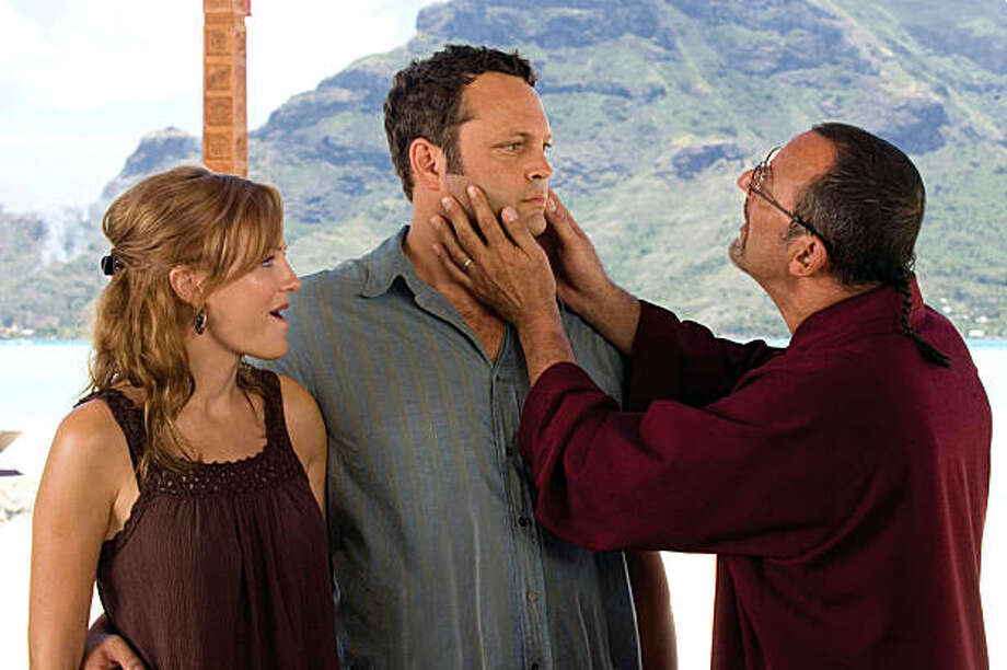 "In this film publicity image released by Universal Pictures, Malin Akerman, left, Vince Vaughn, center, and Jean Reno are shown in a scene from ""Couples Retreat."" (AP Photo/Universal Pictures, John Johnson) Photo: John Johnson, AP"