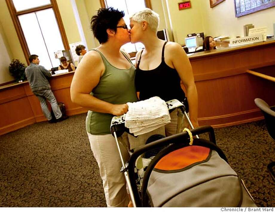 Jill Grove, left, and Keren James kissed as they left the San Francisco Clerk's office Thursday after getting an appointment for June 16th to get a marriage license. They brought their son Gryffen to the event. The California State Supreme Court voted 4-3 to allow same sex marriages and a crowd gathered in front of the state building in San Francisco, Calif. celebrated Thursday, May 15, 2008. Photo by Brant Ward / The Chronicle  Ran on: 05-17-2008  Jill Grove (left) and Keren James, with their son Gryffen, smooch in the San Francisco county clerk's office after making an appointment to get a marriage license on June 16. That's the day many observers expect officials will first be able to implement the California Supreme Court's historic decision allowing same-sex marriages.  Ran on: 05-17-2008 Photo: Brant Ward