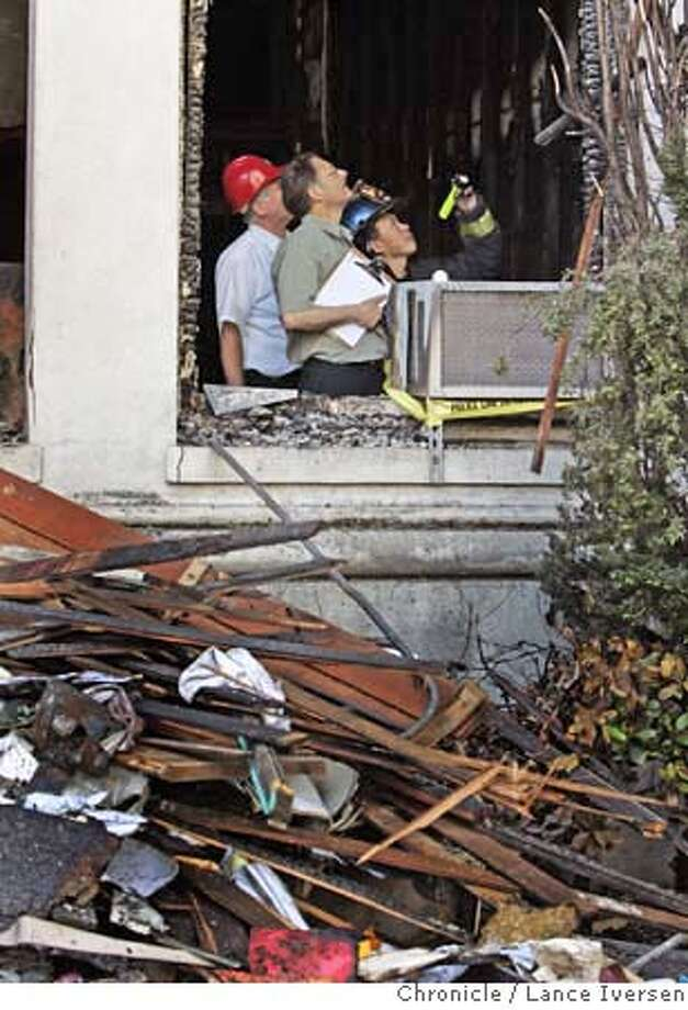 ###Live Caption:A San Francisco Fire Department arson investigation team goes through the ruins on the first floor of the three story fire at 135 Van Ness that damaged much of the San Francisco Public School District Administration Building on Thursday May 15, 2008 in San Francisco, Calif. Photo by Lance Iversen / San Francisco Chronicle.###Caption History:San Francisco Fire Department Arson investigation team goes through the ruins on the first floor of the three story fire at 135 Van Ness that hallowed out much of San Francisco Public School District Administration Building. Thursday May 15, 2008. Photographed at the Corner of Van Ness and Hayes.  Photographed in San Francisco, Calif, By Lance Iversen / San Francisco Chronicle.###Notes:Lance Iversen 415-2979395  CQ###Special Instructions:MANDATORY CREDIT PHOTOG AND SAN FRANCISCO CHRONICLE. Photo: LANCE IVERSEN