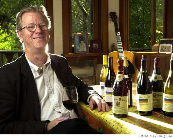 EDMUNDS114_cl.jpg  Photo of Steve Edmunds, owner of Edmunds St. John Winery. Story about his passion for making wines similar to those in France's Rhone Valley. Photos of some of those wines from the Rhone Valley on the table as well as some of his own. Photo was taken at his home in Berkeley. 5/5/03 in Berkeley.  CRAIG LEE / The Chronicle Photo: CRAIG LEE