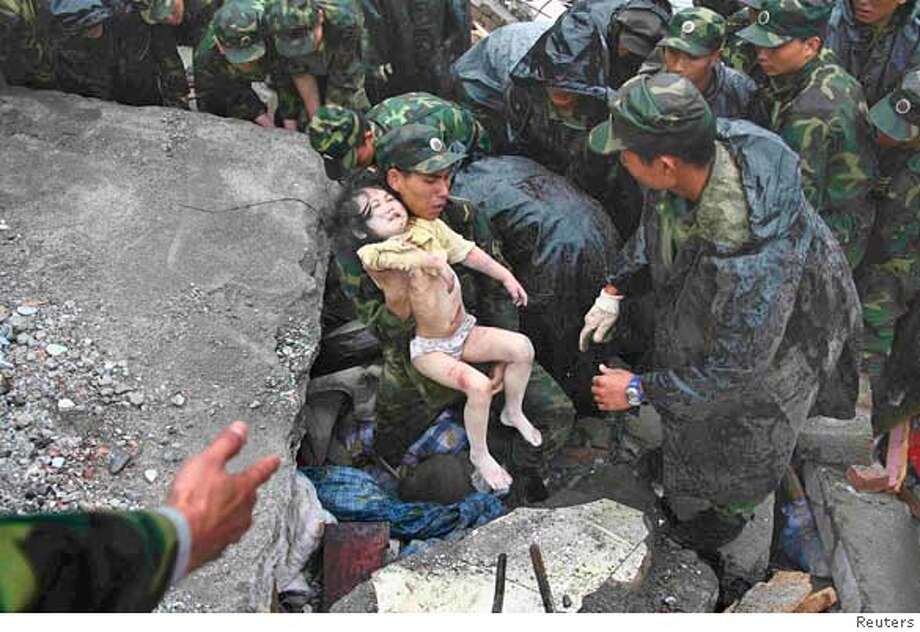 ###Live Caption:Soldiers rescue a child from the rubble after an earthquake in Beichuan, Sichuan province May 13, 2008. Picture taken May 13, 2008. China poured more troops into the earthquake-ravaged province of Sichuan on Wednesday to quicken a search for survivors as time ran out for thousands of people still buried under rubble and mud. REUTERS/Stringer (CHINA)###Caption History:Soldiers rescue a child from the rubble after an earthquake in Beichuan, Sichuan province May 13, 2008. Picture taken May 13, 2008. China poured more troops into the earthquake-ravaged province of Sichuan on Wednesday to quicken a search for survivors as time ran out for thousands of people still buried under rubble and mud. REUTERS/Stringer (CHINA)###Notes:Soldiers rescue a child from the rubble after an earthquake in Beichuan,###Special Instructions:0 Photo: STRINGER/CHINA
