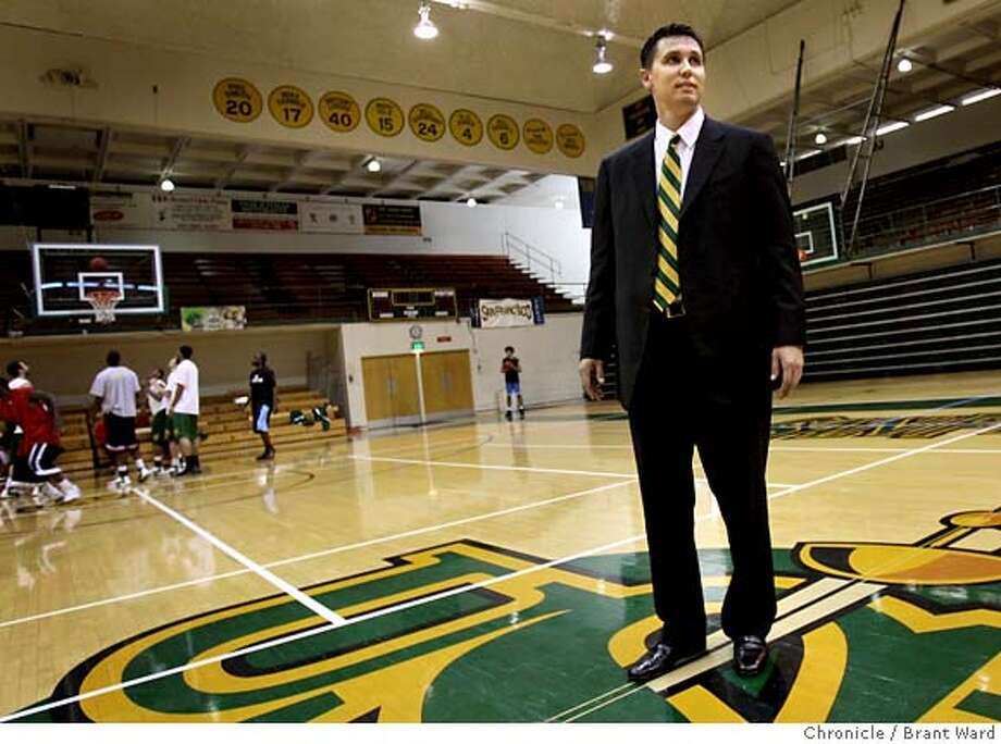 ###Live Caption:New men's basketball coach Rex Walters walks onto the court on campus while some of his players scrimmaged in the background. At a news conference on the University of San Francisco campus, new men's basketball coach Rex Walters was introduced on Monday, April 14, 2008. Photo by Brant Ward / San Francisco Chronicle###Caption History:New men's basketball coach Rex Walters walks onto the court on campus while some of his players scrimmaged in the background. At a news conference on the University of San Francisco campus, new men's basketball coach Rex Walters was introduced on Monday, April 14, 2008. Photo by Brant Ward / San Francisco Chronicle###Notes:###Special Instructions: Photo: Brant Ward
