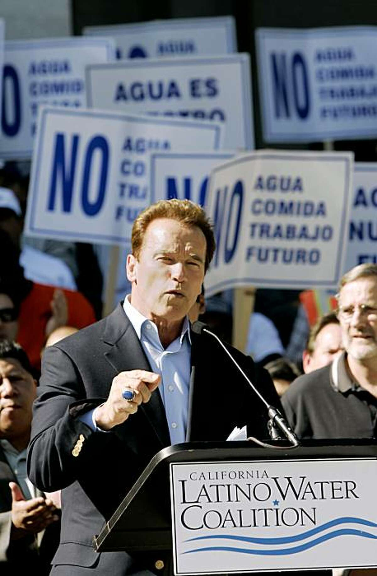 FILE - In this Oct. 9, 2009 file photo, Gov. Arnold Schwarzenegger speaks before a crowd of farm workers and members of a Hispanic water coalition outside the Capitol in Sacramento., Calif. Schwarzenegger and legislative leaders were trying to work out a water deal Sunday Oct. 11, 2009 as a midnight deadline neared for the governor to act on more than 700 bills. (AP Photo/Rich Pedroncelli, File)