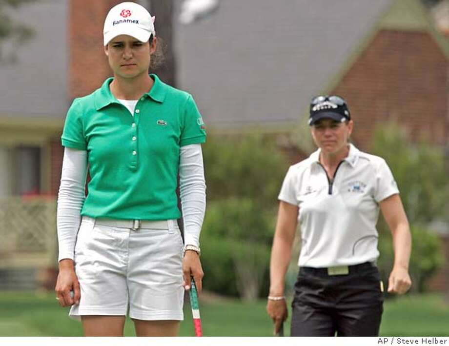 Lorena Ochoa, left, of Mexico, and Annika Sorenstam, of Sweden, look over their putts on the 14th hole during the second round of the Michelob Ultra Open LPGA Golf tournament at Kingsmill Resort in Williamsburg, Va., Friday, May 9, 2008. (AP Photo/Steve Helber) Photo: Steve Helber