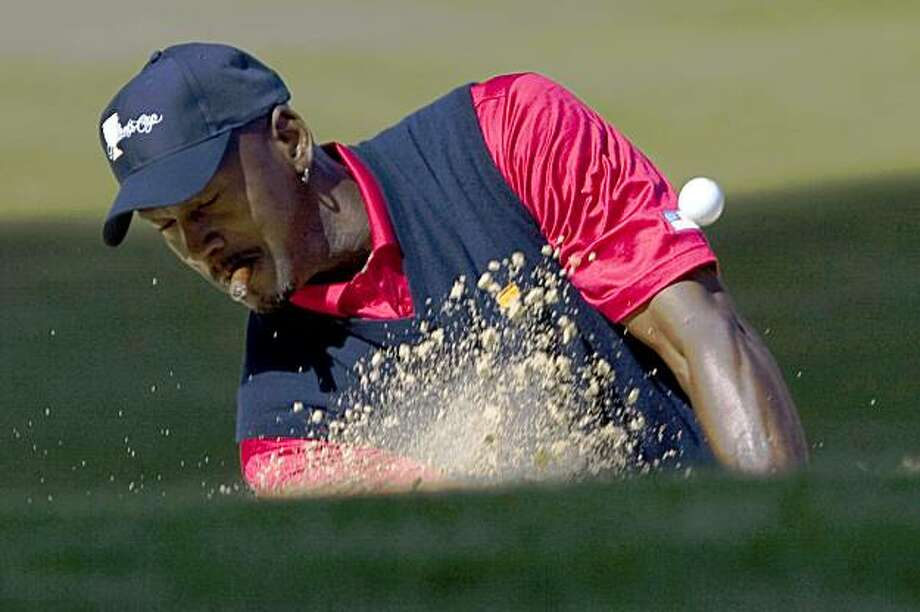 Michael Jordan hits out of the sand trap on the 16th hole at Harding Park Golf Course October 5, 2009 in San Francisco, Calif. (Photograph by David Paul Morris / Special to the Chronicle) Photo: David Paul Morris, Special To The Chronicle