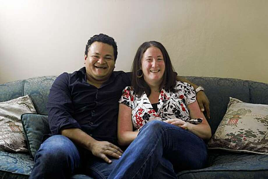 "Jenn Meyers  (right) and Francisco Guerrero fall in love and now are ""on the couch"" for a portrait in there home in Oakland, Calif., on October 3, 2009. Photo: Frederic Larson, The Chronicle"