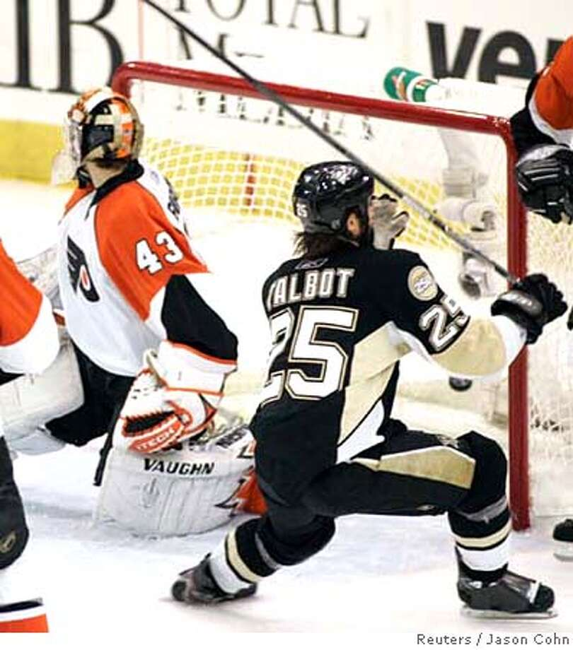 ###Live Caption:Philadelphia Flyers goalie Martin Biron is scored on by Pittsburgh Penguins forward Maxime Talbot (25)during the third period of Game 2 of their NHL Eastern Conference Finals hockey game in Pittsburgh, Pennsylvania, May 11, 2008. REUTERS/Jason Cohn (UNITED STATES)###Caption History:Philadelphia Flyers goalie Martin Biron is scored on by Pittsburgh Penguins forward Maxime Talbot (25)during the third period of Game 2 of their NHL Eastern Conference Finals hockey game in Pittsburgh, Pennsylvania, May 11, 2008. REUTERS/Jason Cohn (UNITED STATES)###Notes:Flyers goalie Martin Biron is scored on by Penguins forward Maxime Talbot in Pittsburgh###Special Instructions:0 Photo: JASON COHN