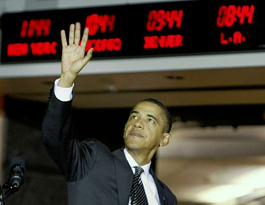 President Barack Obama waves after making remarks to employees at the National Counterterrorism Center in McLean, Va., Tuesday, Oct. 6, 2009. (AP Photo/Gerald Herbert) Photo: Gerald Herbert, AP