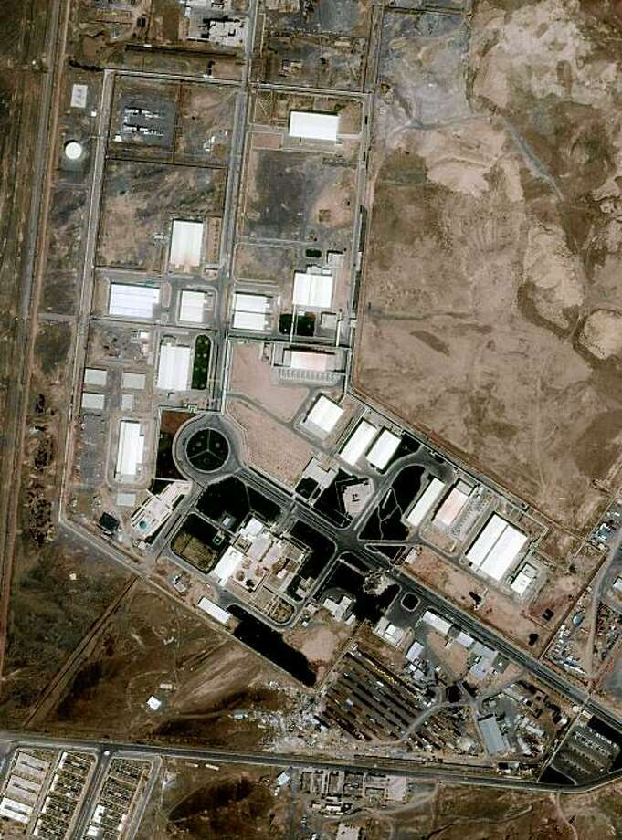 A May 14, 2009 photo taken from 423 miles in space and released Friday, August 21, 2009 by GeoEye Satellite Image shows Iran's uranium-enrichment facility at Natanz. Iran has revealed the existence of a second secret uranium-enrichment plant, the International Atomic Energy Agency said Friday, Sept. 25, 2009. One official, who had access to a review of Western intelligence on the issue, said it was about 100 miles (160 kilometers) southwest of Tehran and was the site of 3,000 centrifuges that could be operational by next year. Iranian officials had previously acknowledged having only one plant, Natanz, which is under IAEA monitoring _ and had denied allegations of undeclared nuclear activities. (AP Photo/GeoEye Satellite Image) Photo: AP