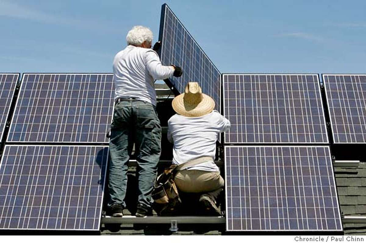 ###Live Caption:Tom Peterson (left) and Peter Gregory install solar panels on Benjamin Yee's home in Emeryville, Calif. on Tuesday, July 17, 2007. Yee says he's the first homeowner to go solar in Emeryville. PAUL CHINN/The Chronicle###Caption History:Tom Peterson (left) and Peter Gregory install solar panels on Benjamin Yee's home in Emeryville, Calif. on Tuesday, July 17, 2007. Yee says he's the first homeowner to go solar in Emeryville. PAUL CHINN/The Chronicle **Tom Peterson, Peter Gregory, Benjamin Yee Ran on: 07-18-2007 Tom Peterson (left) and Peter Gregory install solar panels on Benjamin Yees house in Emeryville. Ran on: 07-18-2007 Tom Peterson (left) and Peter Gregory install solar panels on Benjamin Yees house in Emeryville and become part of a Bay Area trend. Ran on: 07-18-2007###Notes:###Special Instructions:MANDATORY CREDIT FOR PHOTOGRAPHER AND S.F. CHRONICLE/NO SALES - MAGS OUT