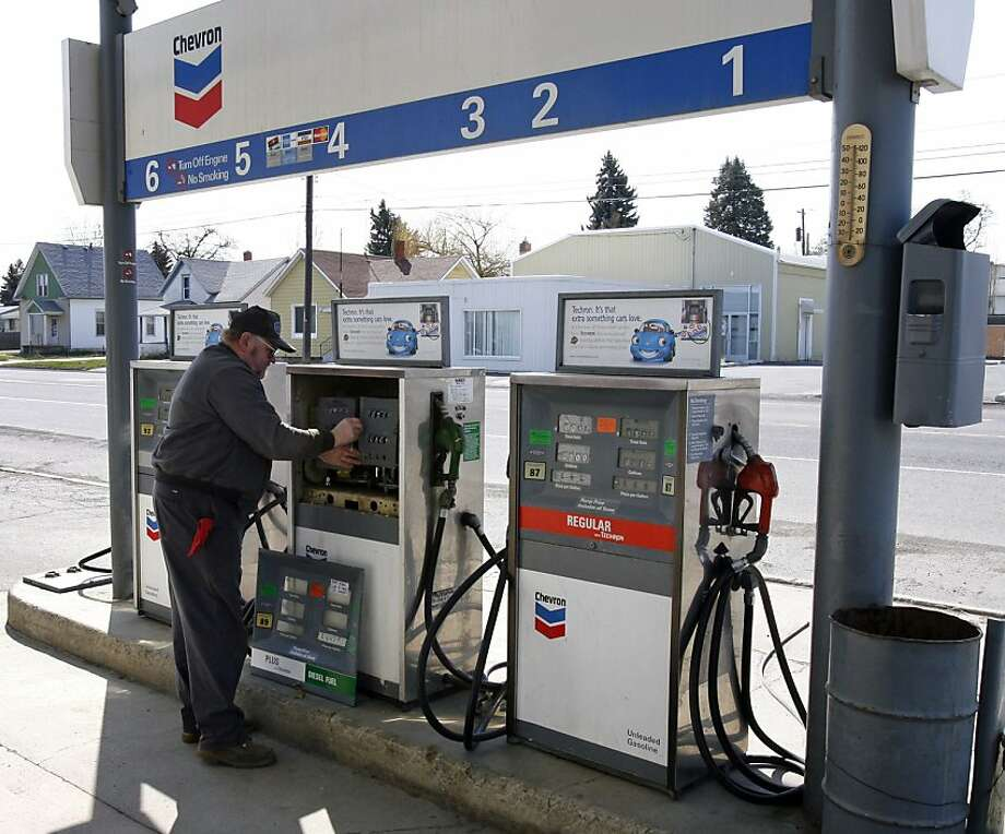 Chip Colville, owner of Colville's, Inc., checks the mechanical meters on a diesel fuel dispenser at his Chevron service station, Friday, April 25, 2008, in Reardan, Wash. The meters on the 30 plus-year-old dispensers stop at $3.999 per gallon.  (AP Photo/Jeff T. Green) Photo: Jeff T. Green, AP