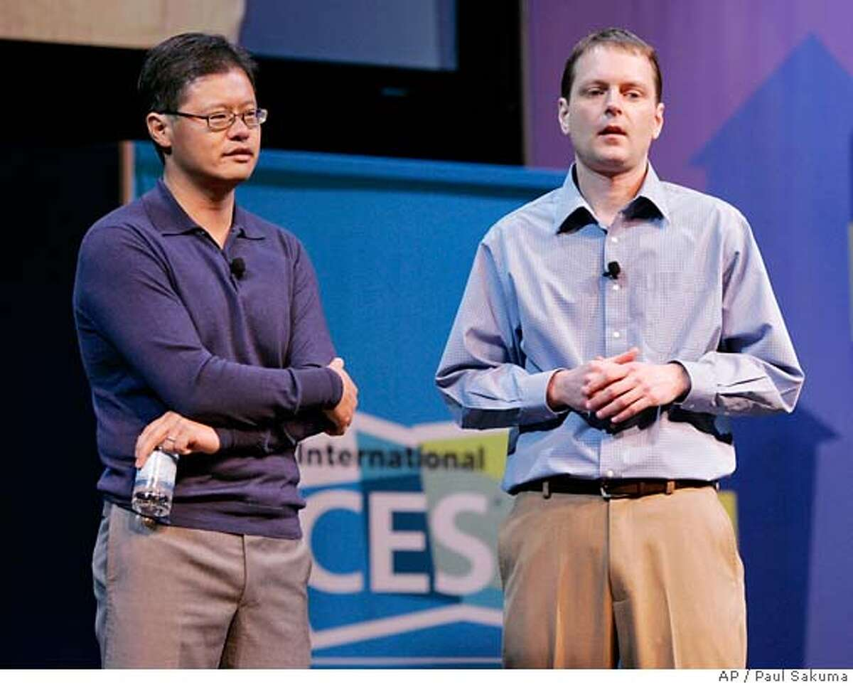 """###Live Caption:Yahoo Chief Executive Officer Jerry Yang said in a statement after Microsoft dropped its bid, """"With the distraction of Microsoft's unsolicited proposal now behind us, we will be able to focus all of our energies on executing the most important transition in our history so that we can maximize our potential to the benefit of our shareholders, employees, partners and users."""" ###Caption History:Yahoo CEO and co-founder Jerry Yang, left, and co-founder David Filo, right, talk during the Consumer Electronic Show (CES) keynote in Las Vegas, Jan. 6, 2008. After fending off months of threats by Microsoft Corp., Yahoo Inc.'s directors still will have to fight for their jobs as the company's own irate shareholders plot a mutiny. (AP Photo/Paul Sakuma)###Notes:Yahoo, Jerry Yang, David Filo###Special Instructions:"""