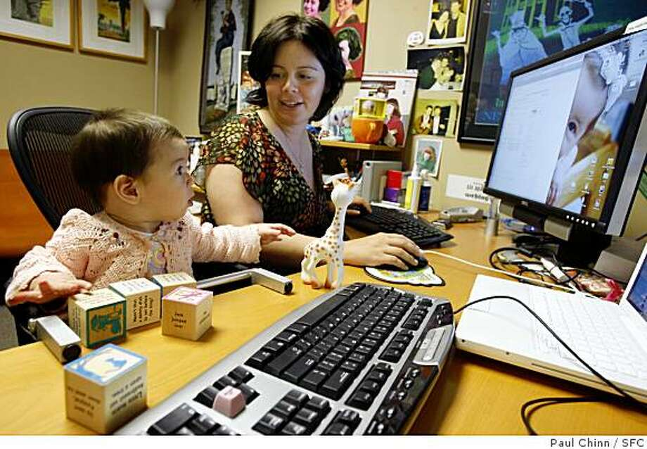 Mena Trott works at her office with her six-month-old daughter Penelope in San Francisco, Calif., on Friday, April 25, 2008. Trott created a blog to chronicle her pregnancy and Penelope's birth so friends and family could get immediate updates.Photo by Paul Chinn / San Francisco Chronicle Photo: Paul Chinn, SFC