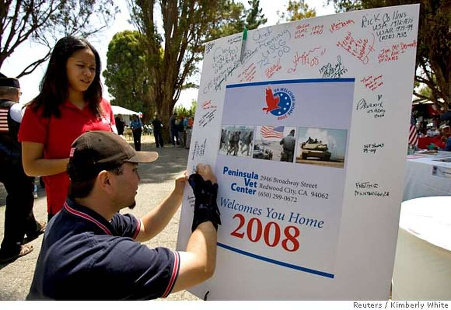 ###Live Caption:James Horuath, an Iraq war veteran, signs a welcome home sign at a picnic event for Iraq and Afghanistan war veterans in Mountain View, California, May 10, 2008. The Department of Veterans Affairs held a 'Welcoming Home' music and picnic event for the veterans offering educational and job resource information. REUTERS/Kimberly White (UNITED STATES)###Caption History:James Horuath, an Iraq war veteran, signs a welcome home sign at a picnic event for Iraq and Afghanistan war veterans in Mountain View, California, May 10, 2008. The Department of Veterans Affairs held a 'Welcoming Home' music and picnic event for the veterans offering educational and job resource information. REUTERS/Kimberly White (UNITED STATES)###Notes:James Horuath, an Iraq war veteran, signs a welcome home sign at a picnic event for Iraq and Afghanistan war veterans in Mountain View###Special Instructions: Photo: KIMBERLY WHITE