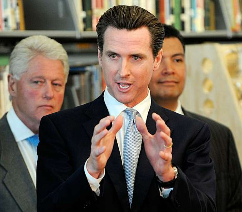 LOS ANGELES, CA - OCTOBER 05:  California gubernatorial candidate San Francisco Mayor Gavin Newsom speaks as former President Bill Clinton looks on during a discussion with students and faculty of Los Angeles City College about education for green technology jobs on October 5, 2009 in Los Angeles, California.  Clinton was in Los Angeles to help raise funds for Newsom's campaign for California governor.  (Photo by Kevork Djansezian/Getty Images) Photo: Kevork Djansezian, Getty Images