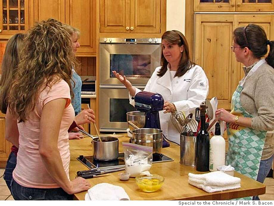 Culinary Director Lara Ritchie teaches students at the Nothing To It Cooking School in REno, Nev. Ran on: 05-11-2008  Culinary Director Lara Ritchie demonstrates proper techniques during a class at the Nothing to It Culinary Center in Reno. Photo: Mark S. Bacon / Special To The C