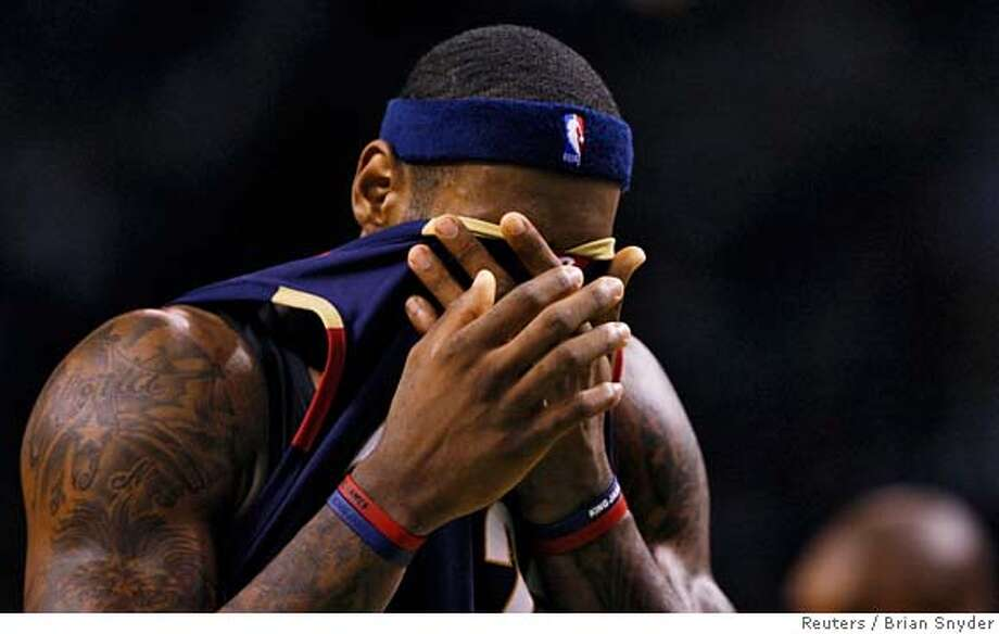 ###Live Caption:Cleveland Cavaliers' Lebron James reacts during third quarter play against the Boston Celtics in Game 2 of their NBA Eastern Conference semi-final basketball playoff series in Boston, Massachusetts May 8, 2008. REUTERS/Brian Snyder (UNITED STATES)###Caption History:Cleveland Cavaliers' Lebron James reacts during third quarter play against the Boston Celtics in Game 2 of their NBA Eastern Conference semi-final basketball playoff series in Boston, Massachusetts May 8, 2008. REUTERS/Brian Snyder (UNITED STATES)###Notes:Cleveland Cavaliers' James reacts during third quarter play against the Boston Celtics in Game 2 of their NBA Eastern Conference semi-final basketball playoff series in Boston###Special Instructions:0 Photo: BRIAN SNYDER