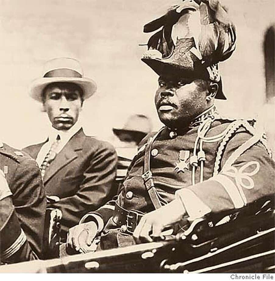 Marcus Garvey riding in a parade, circa 1922. Chronicle file photo