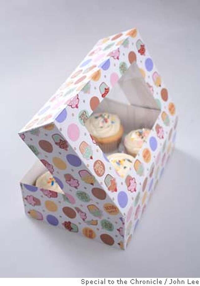 ###Live Caption:WHATS07_CUPCAKE_04_JOHNLEE.JPG  MAY 1, 2008: Cupcakes in box.  BY JOHN LEE / SPECIAL TO THE CHRONICLE###Caption History:WHATS07_CUPCAKE_04_JOHNLEE.JPG  MAY 1, 2008: Cupcakes in box.  BY JOHN LEE / SPECIAL TO THE CHRONICLE###Notes:###Special Instructions: Photo: John Lee