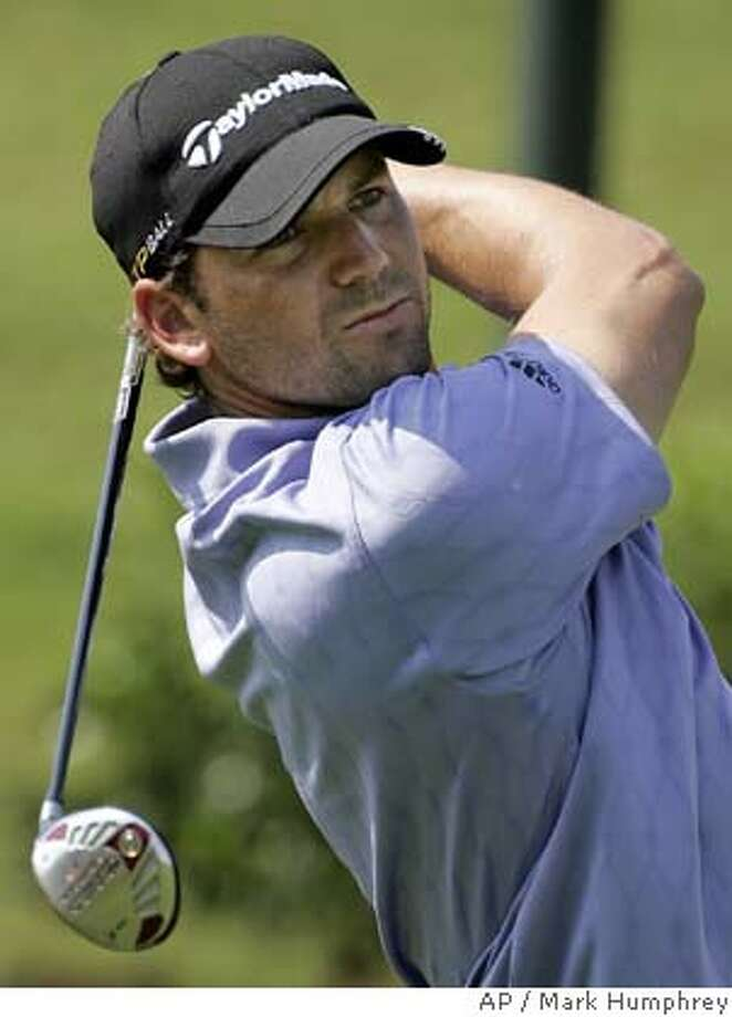 Sergio Garcia of Spain hits his tee shot on the 18th hole at The Players Championship golf tournament in Ponte Vedra Beach, Fla., Thursday, May 8, 2008. Garcia took a par on the hole. (AP Photo/Mark Humphrey) Photo: Mark Humphrey