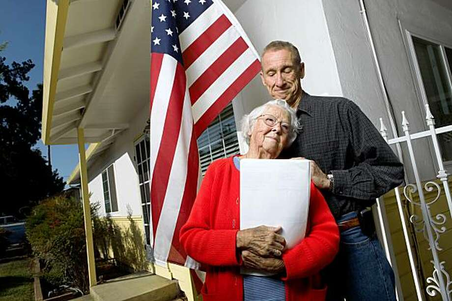 SAN JOSE, CA---Laverne Kidwiler, 86, thought it was a good idea to take out a reverse mortgage on her San Jose home. Kidwiler holds a copy of the mortgage in her arms. However, as with the case of many reverse mortgages she has eaten up almost all the equity in her home. Reverse mortgages are rising-debt loans so the interest is added to the loan balance each month. As the interest compounds, the interest owed increases significantly. Kidwiler's son Marvin Kidwiler is very concerned about his mom and the state of her loan. Photo: Tomas Ovalle, Special To The Chronicle