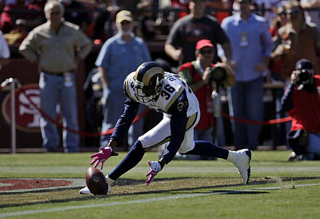 The Rams' Quincy Butler muffs the punt return and the 49ers recover in the end zone for the first score of the game in the second quarter at Candlestick Park in San Francisco on Sunday. Photo: Carlos Avila Gonzalez, The Chronicle