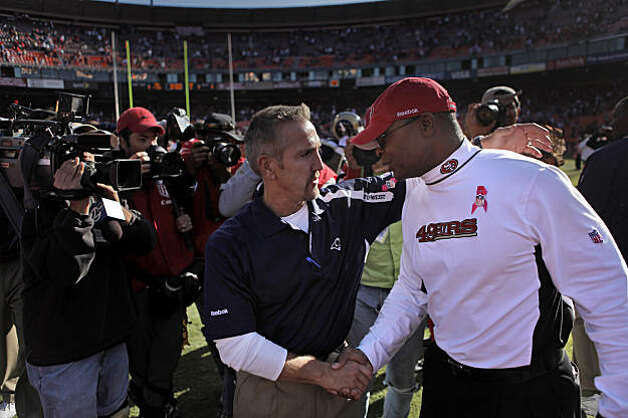 Rams head coach Steve Spagnuolo congratulates 49ers coach Mike Singletary at the end of the game at Candlestick Park in San Francisco on Sunday. Photo: Carlos Avila Gonzalez, The Chronicle