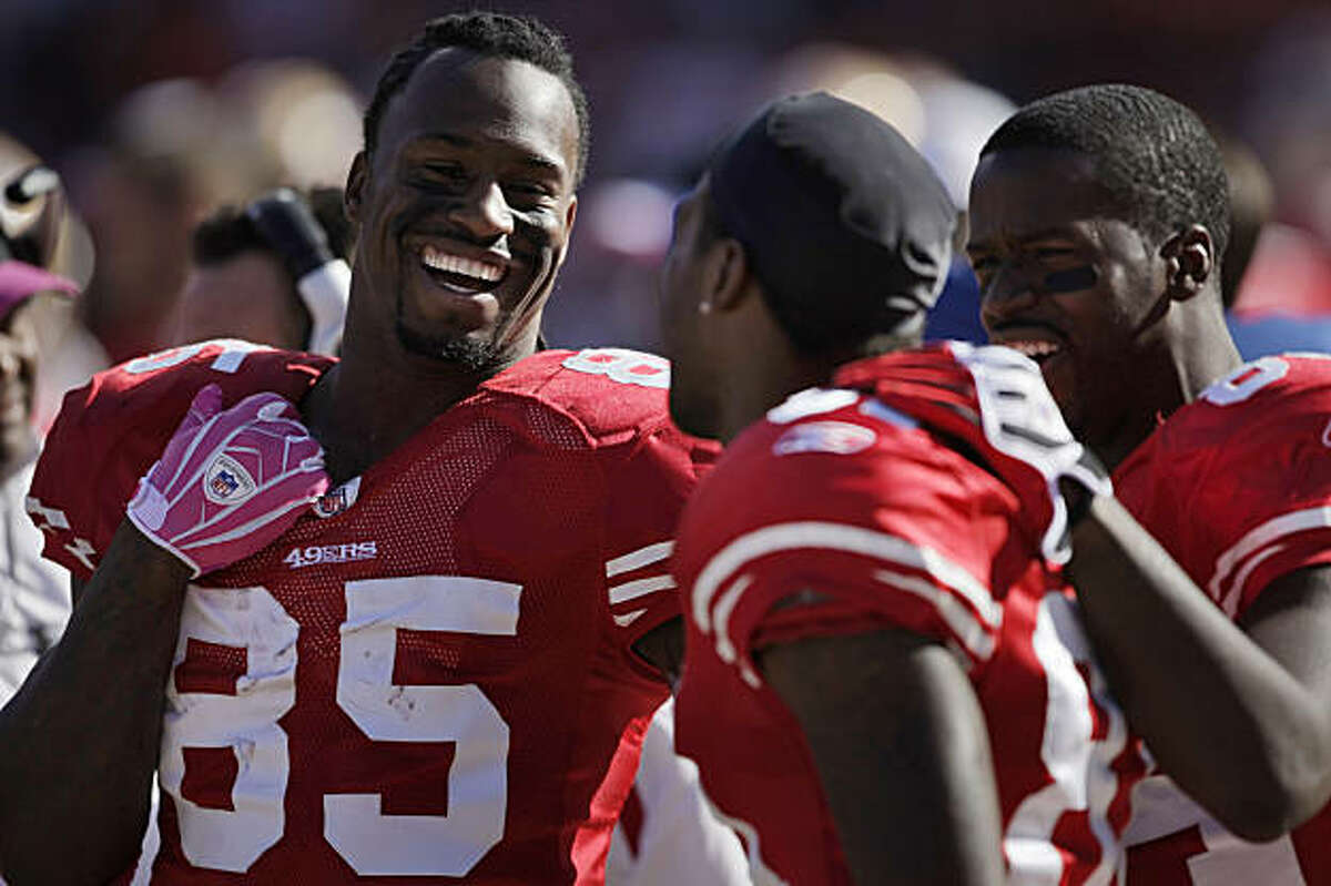 49ers tight end Vernon Davis laughs with teammates Brandon Jones, center and Josh Morgan. The San Francisco 49ers beat the St. Louis Rams at Candlestick Park in San Francisco on Sunday.