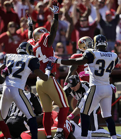 The 49ers' Michael Robinson celebrates the Rams' botched punt return recovered by Scott McKillop for a touchdown. The 49ers played the St. Louis Rams at Candlestick Park in San Francisco on Sunday. Photo: Carlos Avila Gonzalez, The Chronicle