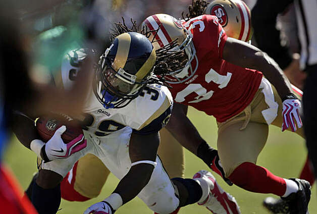 The 49ers Dre' Bly knocks the Rams' Steven Jackson out of bounds in the second quarter. The 49ers defense held St. Louis to 95 yards at Candlestick Park in San Francisco on Sunday. Photo: Carlos Avila Gonzalez, The Chronicle
