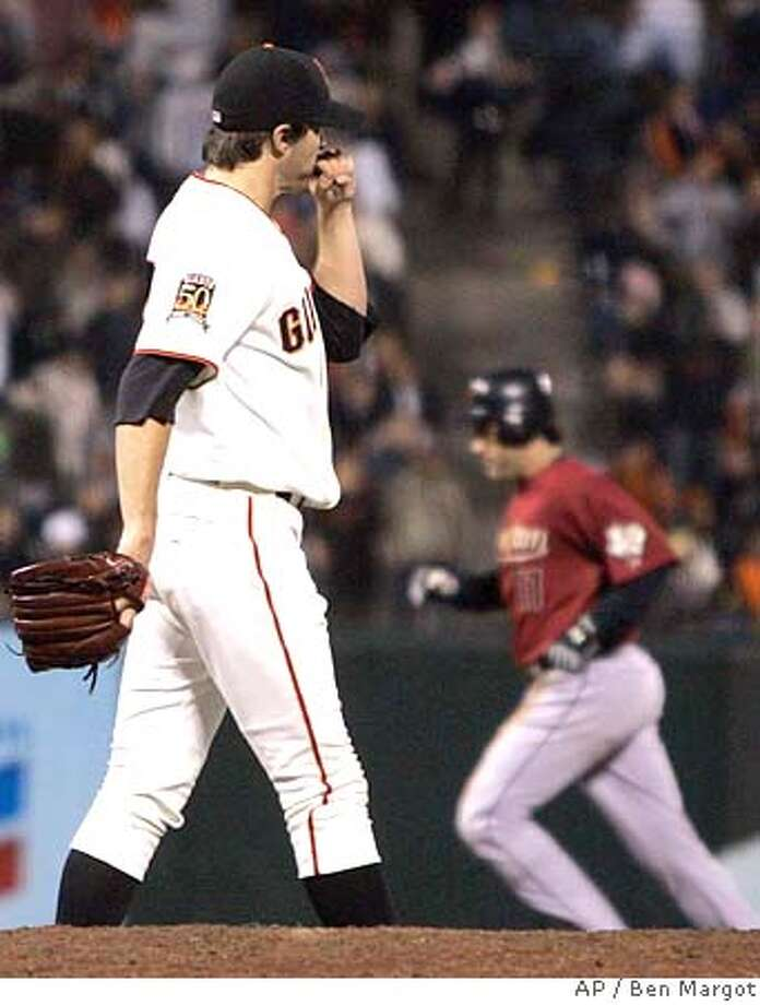 San Francisco Giants pitcher Barry Zito, left, waits for Houston Astros Lance Berkman, right, to round the bases after Berkman hit a three-run home run during the sixth inning of a baseball game Monday, May 12, 2008, in San Francisco. (AP Photo/Ben Margot) Photo: Ben Margot