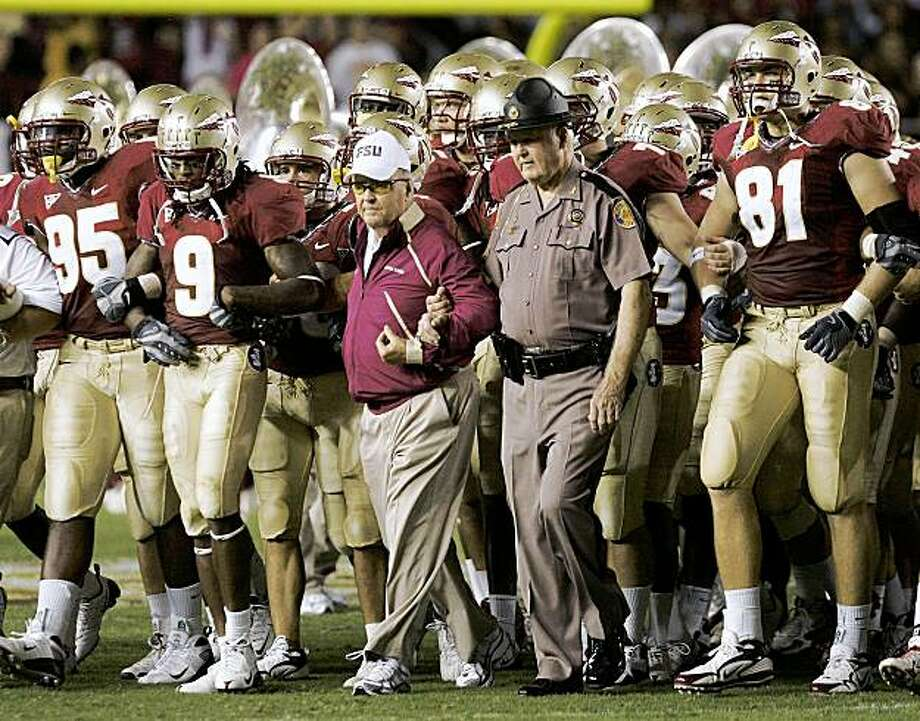 Florida State head coach Bobby Bowden, center, walks out with the team prior to the start of a NCAA football game against Georgia Tech on Saturday, Oct. 10, 2009, in Tallahassee, Fla.  (AP Photo/Steve Cannon) Photo: Steve Cannon, AP