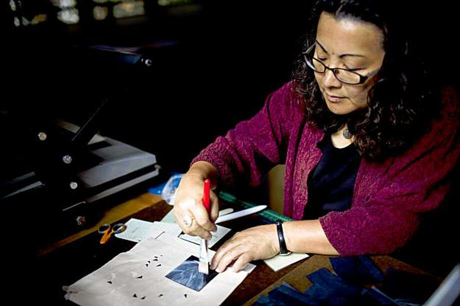 "Bookmaker Julie Chen assembles a piece of her recent book ""View"" at her home studio in Berkeley, Calif. on Friday, Sept. 25, 2009. Working in small limited quantities, Chen designs and creates various one of a kind three dimension books. She was also recently featured in PBS' Peabody-award winning Craft In America. Photo: Stephen Lam, The Chronicle"