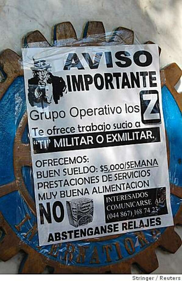 "A flyer posted on a monument reads: ""The Zetas want you, soldier or former soldier. We offer good salary, food and family care. Don't go hungry any longer"", in the border city of Nuevo Laredo April 14, 2008. In one of its most audacious acts yet, Mexico's Gulf cartel drug gang this week of April openly advertised for troops to desert its ranks to join a fight that has killed some 900 people this year. The cartel's feared Zetas hit squad strung banners from bridges over main roads in the towns of Reynosa and Nuevo Laredo on the U.S. border offering well-paid jobs.  REUTERS/Stringer (MEXICO) Photo: Stringer, Reuters"