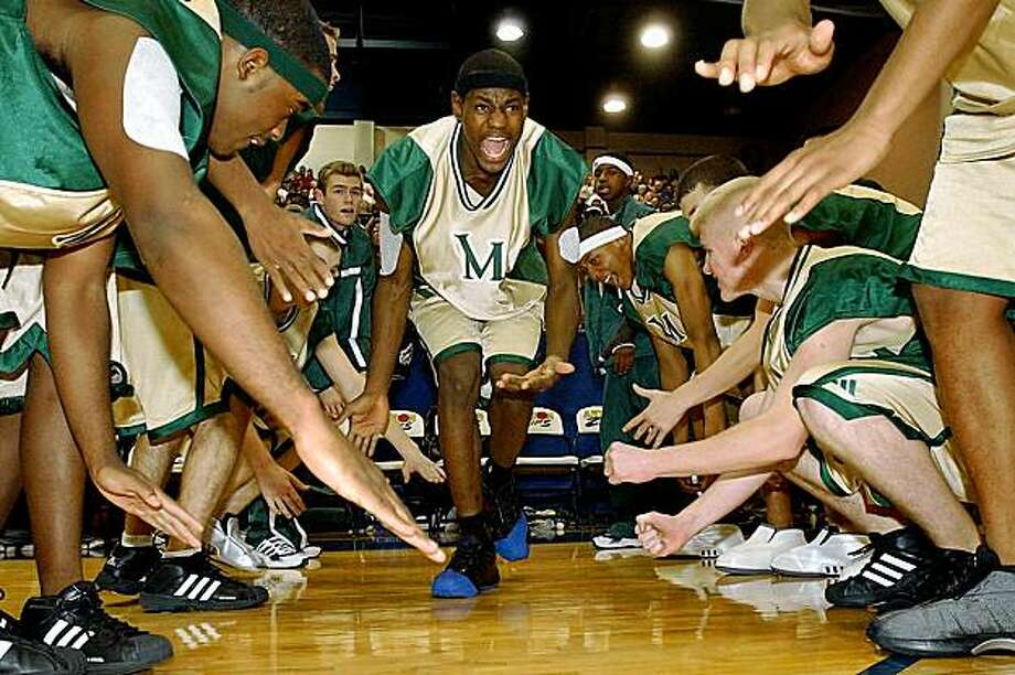LeBron James (center) with St. Vincent-St. Mary's basketball team, as seen in MORE THAN A GAME. Photo courtesy of Lionsgate Photo: Lionsgate