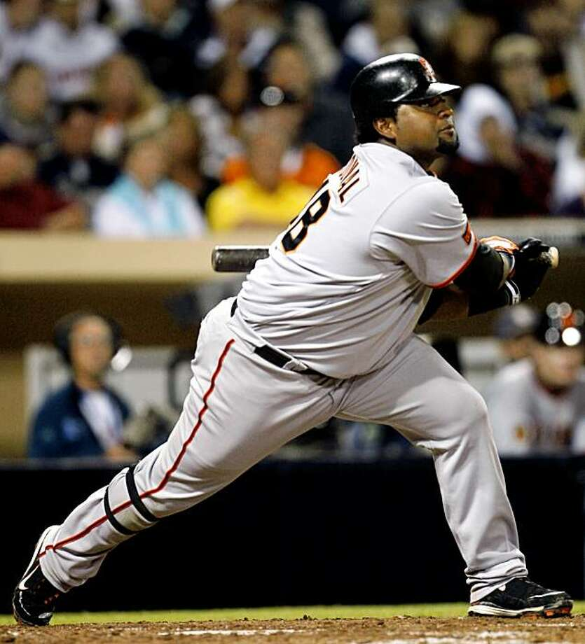San Francisco Giants' Pablo Sandoval makes an off balance swing while popping up to right with two runners on base to end the sixth inning against the San Diego Padres in a baseball game  Saturday, Oct. 3, 2009 in San Diego.  (AP Photo/Lenny Ignelzi) Photo: Lenny Ignelzi, AP
