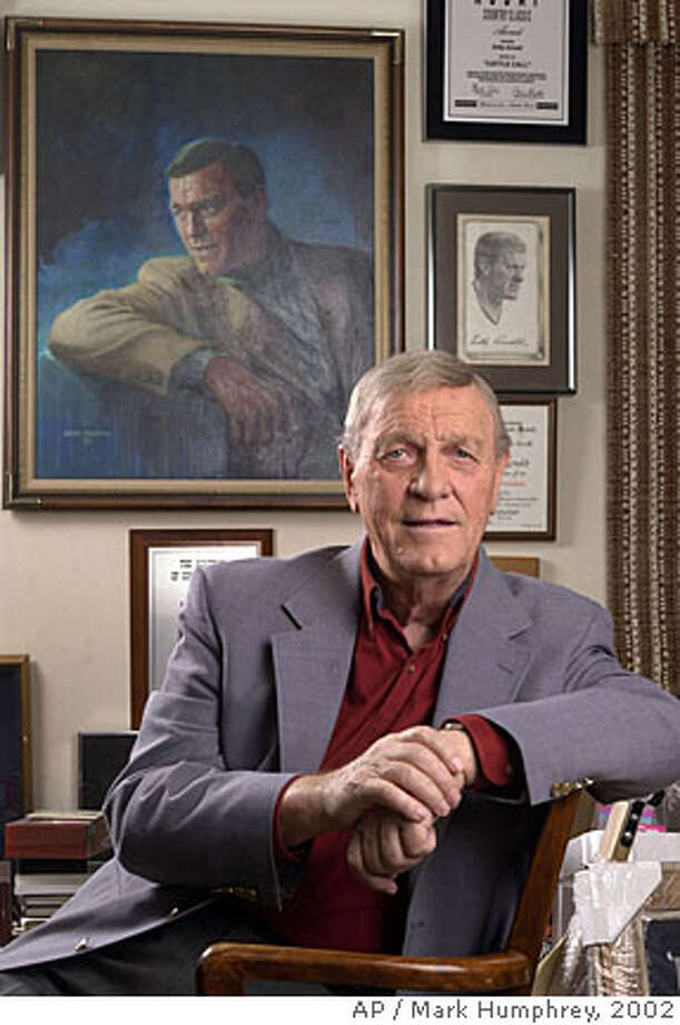 ** In this Jan. 18, 2002 file photo, country music legend Eddy Arnold is shown in his memorabilia-filled office in Brentwood, Tenn. Arnold died at a care facility near Nashville Thursday morning May 8, 2008. He was 89. (AP Photo/Mark Humphrey,File) Photo: MARK HUMPHREY